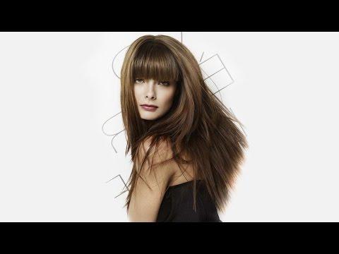 Слоистая женская стрижка с прямой челкой для длинных волос