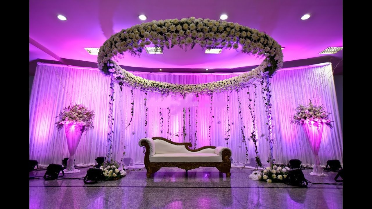 Wedding stage decoration with flowers and lights stage design