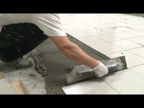 Как правильно наносить плиточный клей при укладке плитки на пол