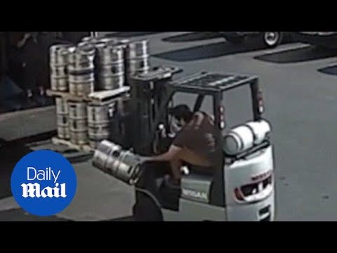 Forklift driver shows his reflexes by catching falling keg - Daily Mail
