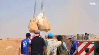 رافعات تُدخل 650 طناً من المساعدات لنازحي سوريا بالأردن