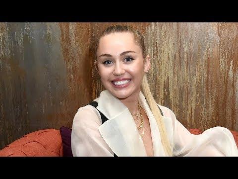 Miley Cyrus REVEALS BABY BUMP!?
