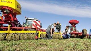 Drei Grünlandstriegel mit Walze im top agrar-Test