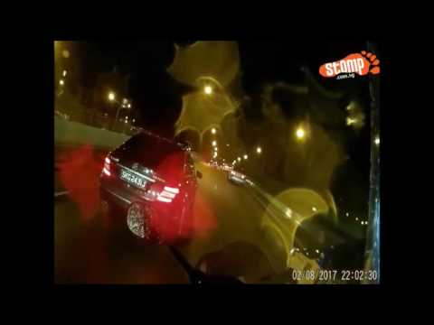 Biker catches Merc driver using phone while driving