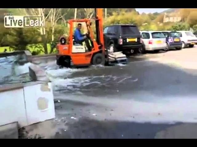 Forklift destroys car park fish pond Travel Video