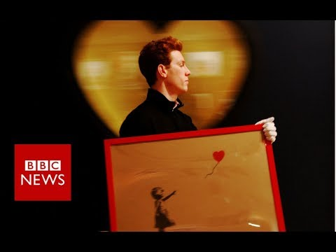 Banksy artwork self-destructs after £1m auction sale - BBC News
