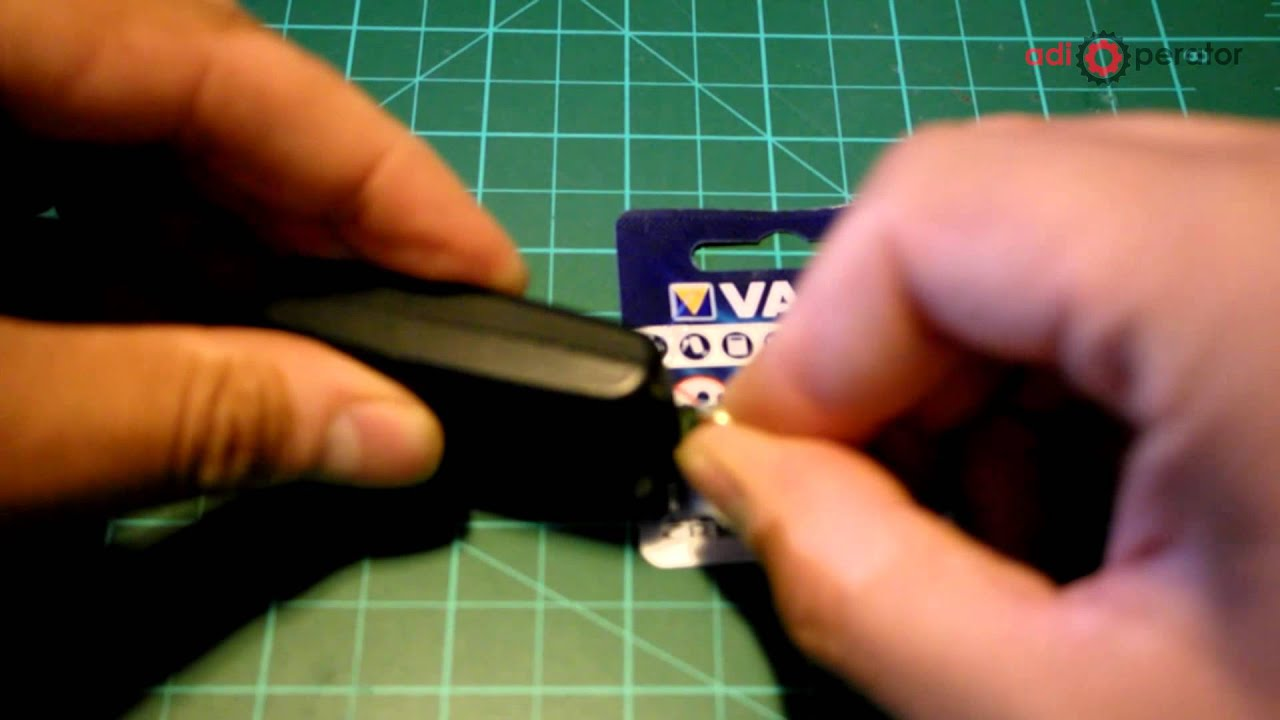 changing the battery on remote control peugeot and citroen - youtube