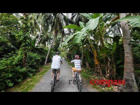 Cycling around Cocohut homestay Ben Tre , Mekong Delta Vietnam