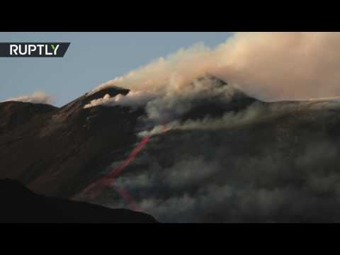 Erupting Etna: Europe's most active volcano continues to spew lava & smoke