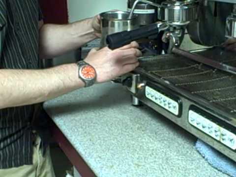 Cleaning the espresso machine