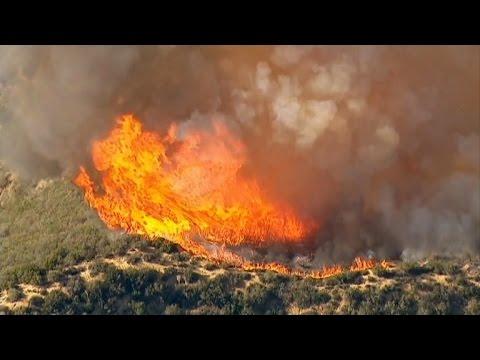 Wildfires surround central Washington town of Chelan