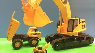 Mighty Wheels Big Truck (toy) needs loading help from a ginormous Mighty Wheels Excavator