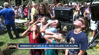 Hundreds gather at St. Pete College for eclipse