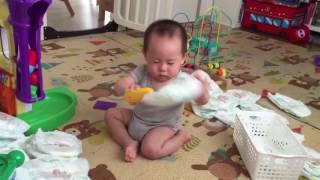 Baby industriously scans diapers