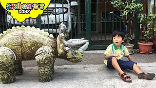 There's a giant triceratops dinosaur in our village and we're about...
