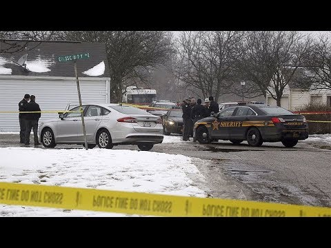 Two Ohio police officers killed on duty, suspect held
