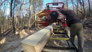 Logs from Andrew Camarata turned into boards for a building