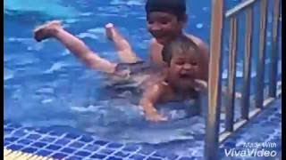 Young Boy And Young Girl Learn How To Swim