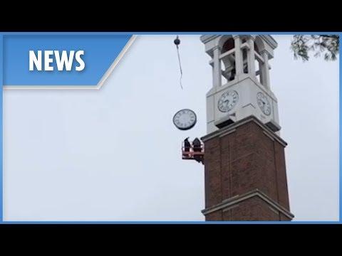 Near miss as giant clock plummets from 160ft Purdue bell tower