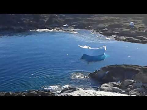 Iceberg flips over in Greenland