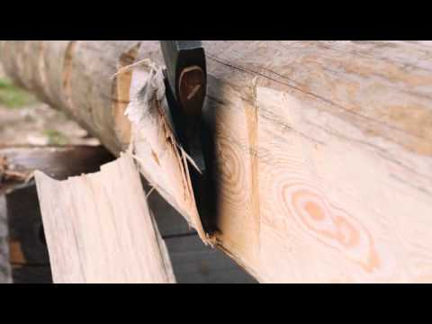 hand-hewing-pine-logs