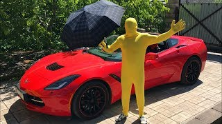 Yellow Man ride on Convertible Corvette in Rain w/ Colored Man under an umbrella for Kids