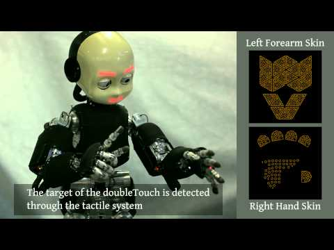 Automatic kinematic chain calibration using artificial skin
