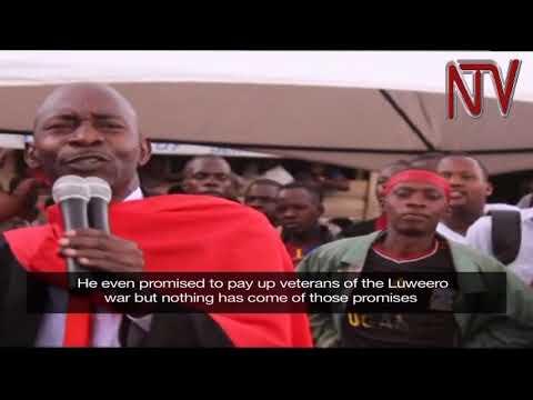 Nakaseke south MP, Luttamaguzi Ssemakula gives residents the Age Limit consultation money.