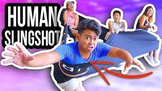 THE HUMAN SLINGSHOT!