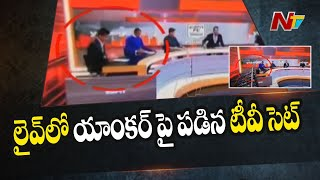 Lucky Escape For TV Anchor As Part Of Set Falls On Him | Viral Video |  NTV