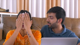 Indian Woman looks worried and her husband comforts her - Email account hacked