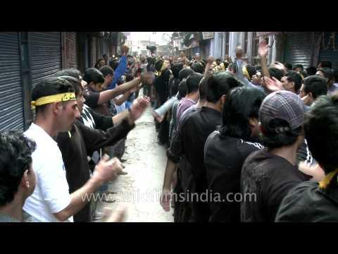 Shia Muslim man wears Facebook T-shirt and beats chests on Ashura!