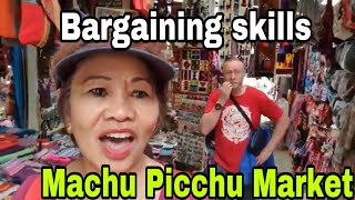 FILIPINO-BRITISH COUPLE BARGAINING SKILLS AT MACHU PICCHU MARKET, PERU