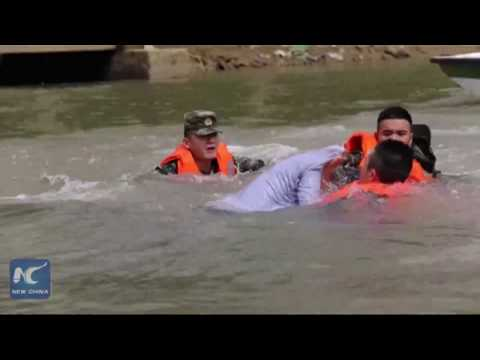 Armed police rescue man from river in 10 min.