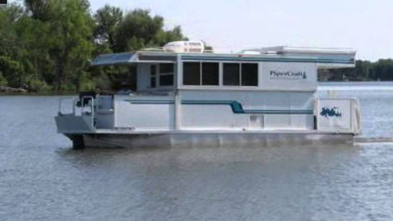 Trailerable Houseboat For Sale This trailerable houseboat is
