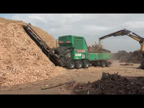 New Holland and heavy wood chipper JENZ large logs chipped to pieces 2013