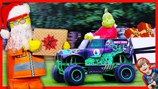 Grave Digger Monster Truck and Lego Santa Deliver Christmas Presents!