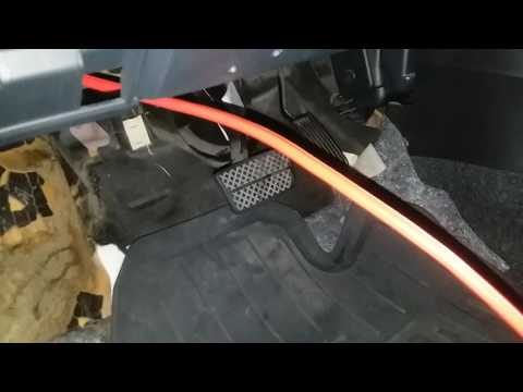 Where to install an accessory power cable in the firewall of a 2008 Honda Fit. Video 2 of 2