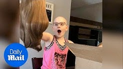 Heartwarming moment little girl with alopecia receives a wig