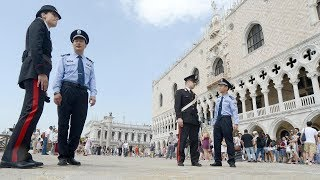 Chinese officers patrol with Italian counterparts as part of security cooperation project