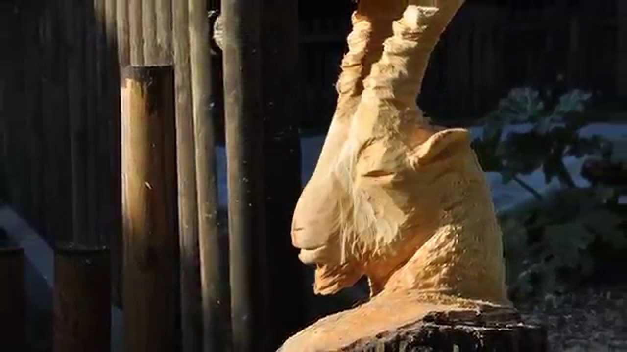 Chainsaw carving ibex head kettensägen schnitzen