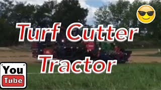 Grass Cutting and Stacking Rolls of Grass Sod Turf Farm Tractor