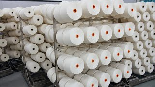 Pan shot of thread spools in a textile factory