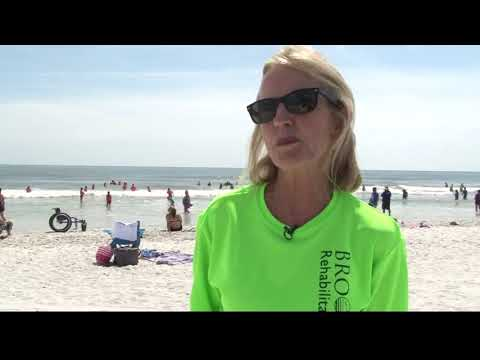 Disabled residents given chance to surf during volunteer event at Jacksonville Beach