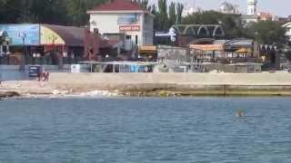 Один из пляжей Феодосии(Крым . Феодосия .Пляж http://www.krymvideo.com Crimea video видео., 2014-07-27T20:28:29.000Z)