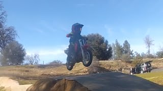 kid rides motorcycle on mini supercross track (4yrs old)
