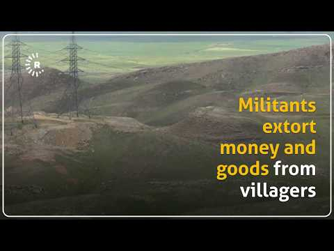 Islamic State militants are filmed in a mountain range, northern Iraq