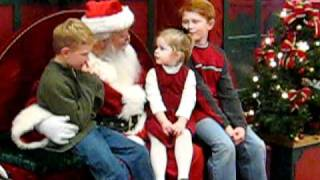 Military dad surprises children visiting mall Santa