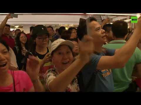 Pro-Chinese government demonstrators rally at Hong Kong shopping center