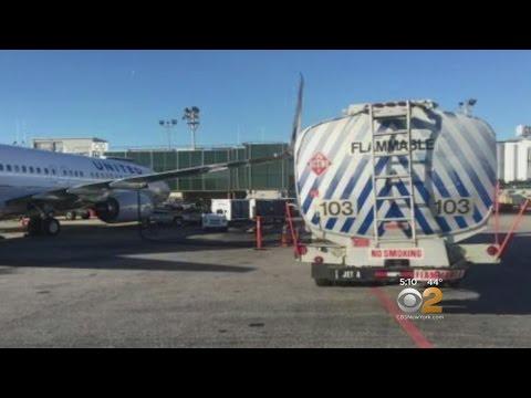 Plane Clips Truck At LaGuardia Airport